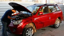 Visually impaired neighborhood mechanic uses touch, sound to fix cars in Iraq