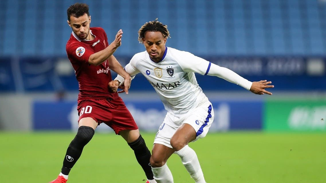 Al-Hilal's midfielder Andre Carrillo (R) is marked by Shahr Khdro's midfielder Rouhollah Seifollahi (L) during the AFC Champions League group B match. (AFP)