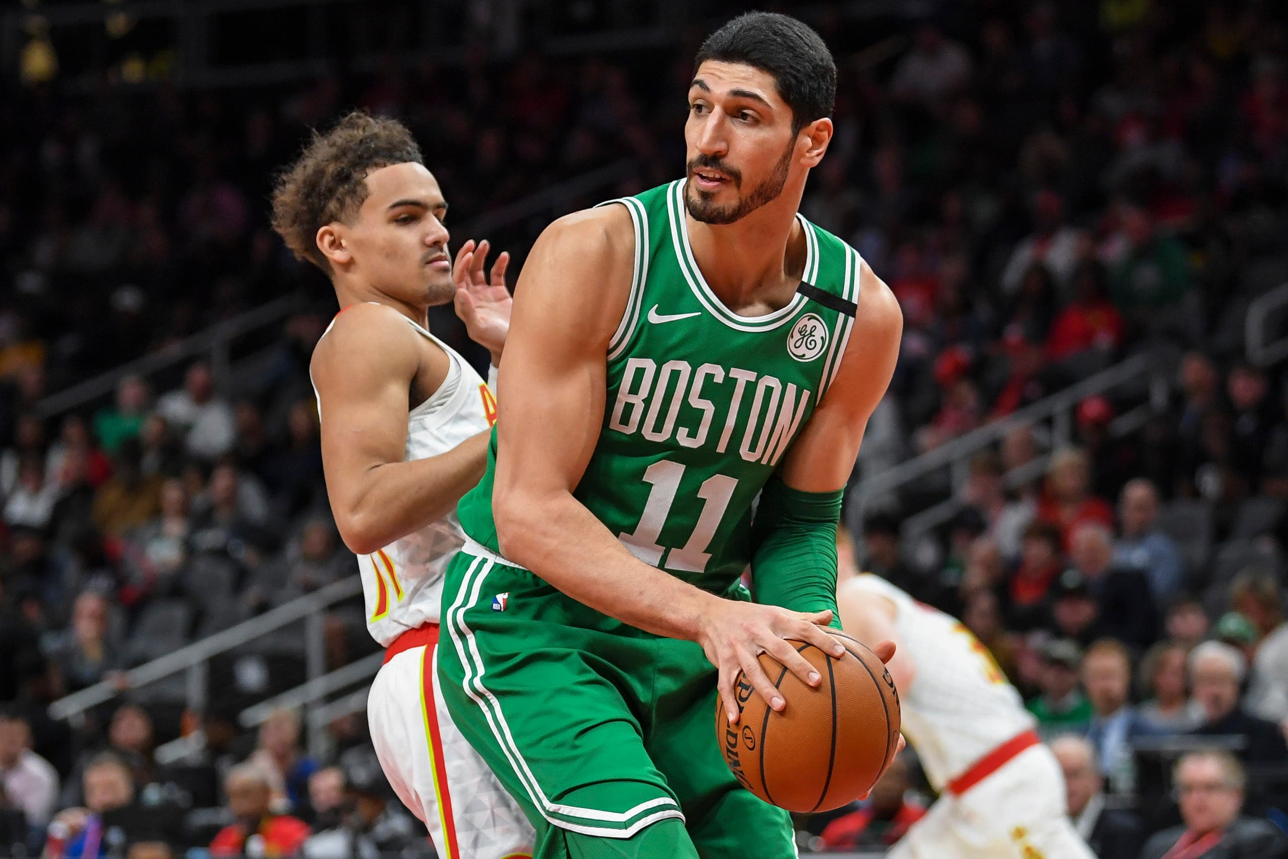 Boston Celtics center Enes Kanter (11) controls the ball against Atlanta Hawks guard Trae Young (left) on February 4, 2020. (Reuters)