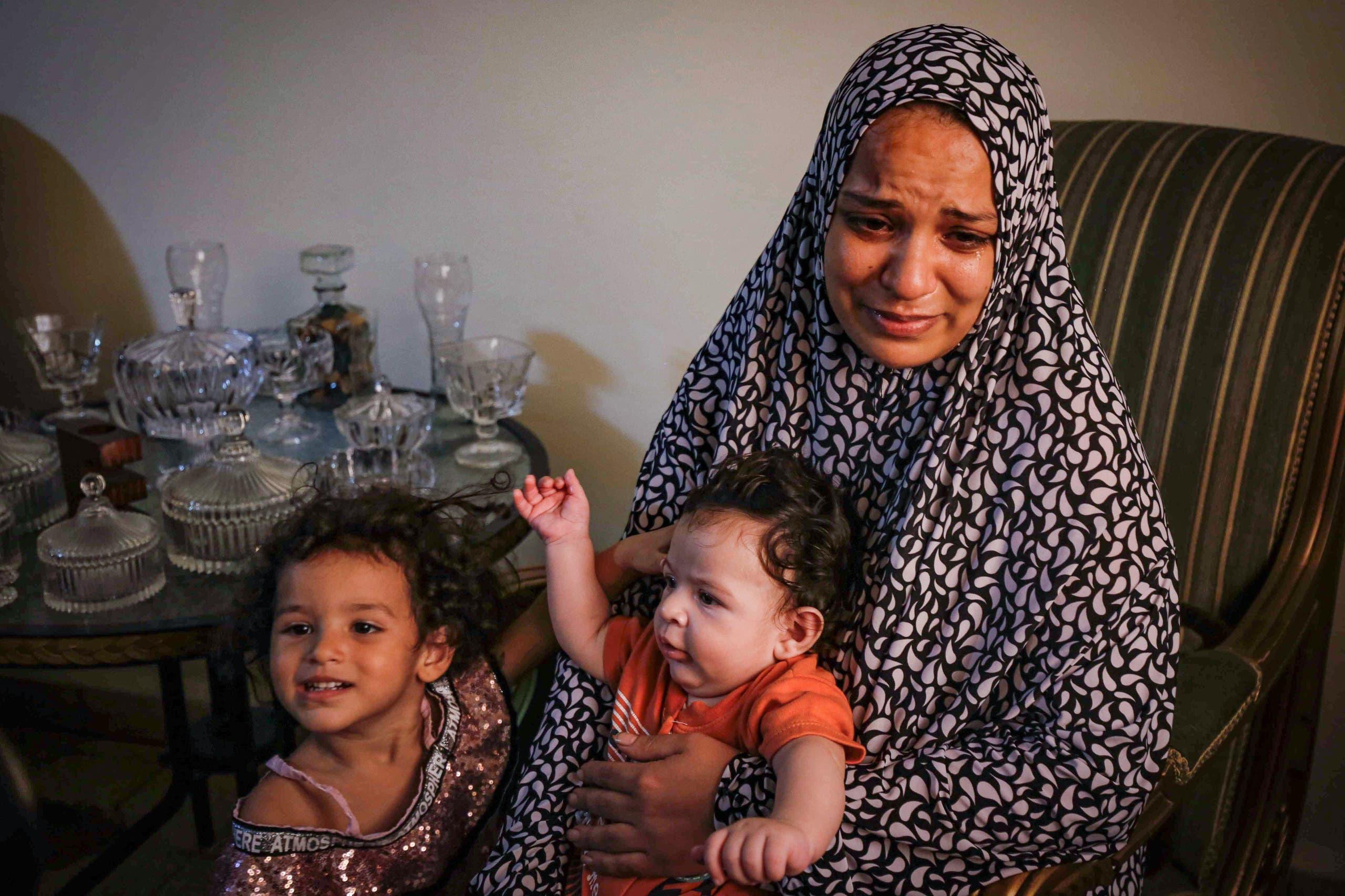 زوجة أحد السوريين المفقودين في قوارب الموت(أرشيفية- فرانس برس)