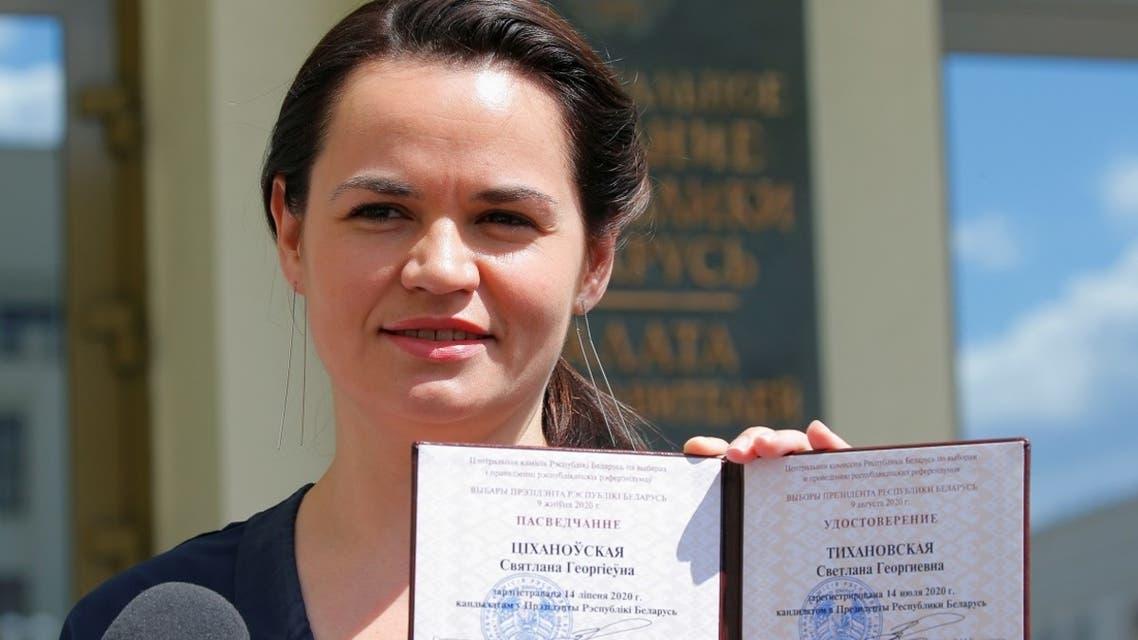 Belarusian opposition leader Svetlana Tikhanovskaya shows her registration certificate as she leaves the election commission in Minsk, July 14, 2020. (Reuters)