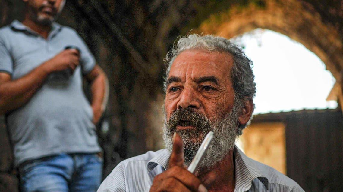 والد أحد الشبان اللبنانيين المفقودين في قوارب الموت (أرشيفية- فرانس برس)