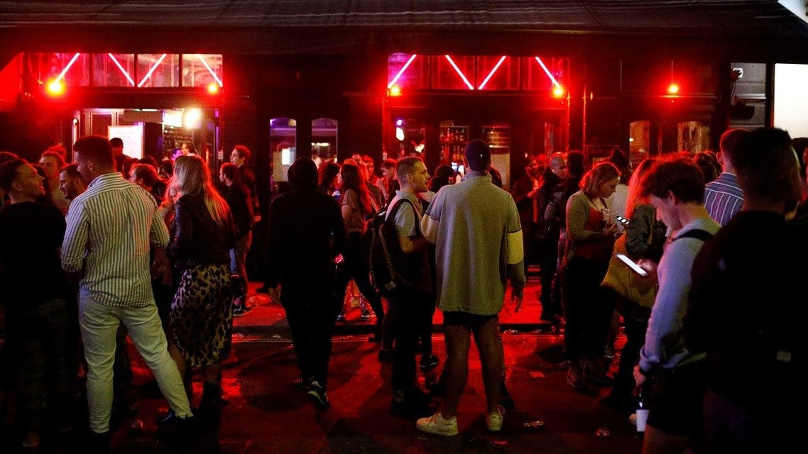 People gather at a bar, following the outbreak of the coronavirus disease (COVID-19), in London. (Reuters)