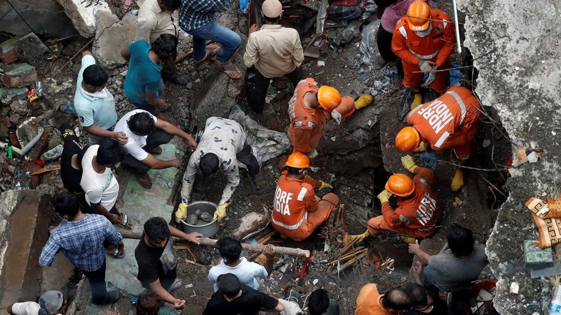 2020-09-National Disaster Response Force (NDRF) officials search for survivors as people help clear the rubble after a three-storey building collapsed in Bhiwandi, on the outskirts of Mumbai, India, on September, 21 2020. (Reuters)22T082122Z_1352974902_RC2K3J9DB3K3_RTRMADP_3_INDIA-COLLAPSE