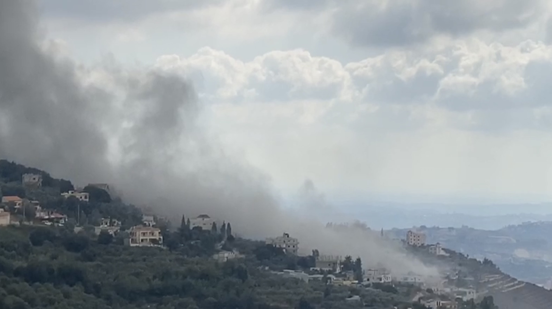 Smoke rises from a fire in the village of Ain Qana in southern Lebanon. (Screengrab)-explosion-heard-