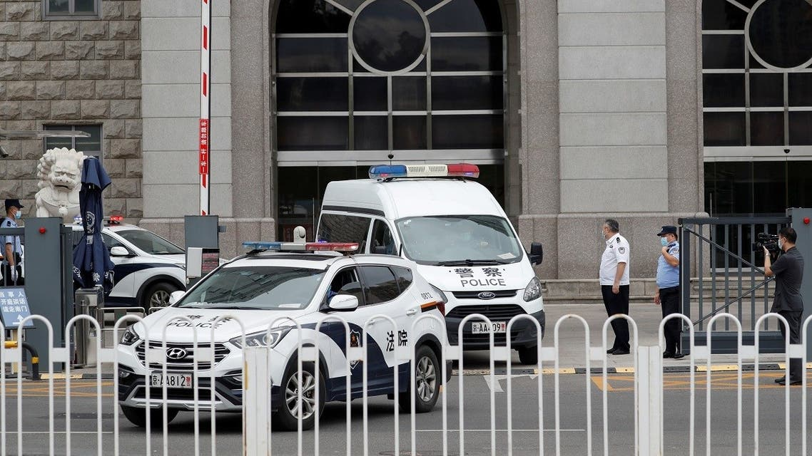 2020-09-2An escorted police van believed to be carrying  Ren Zhiqiang leaves Beijing No. 2 Intermediate People's Court, where Ren faces corruption trial, in Beijing, China, on September 11, 2020. (Reuters)2T044403Z_1288814088_RC2G3J9NK66A_RTRMADP_3_CHINA-POLITICS-DISSENT