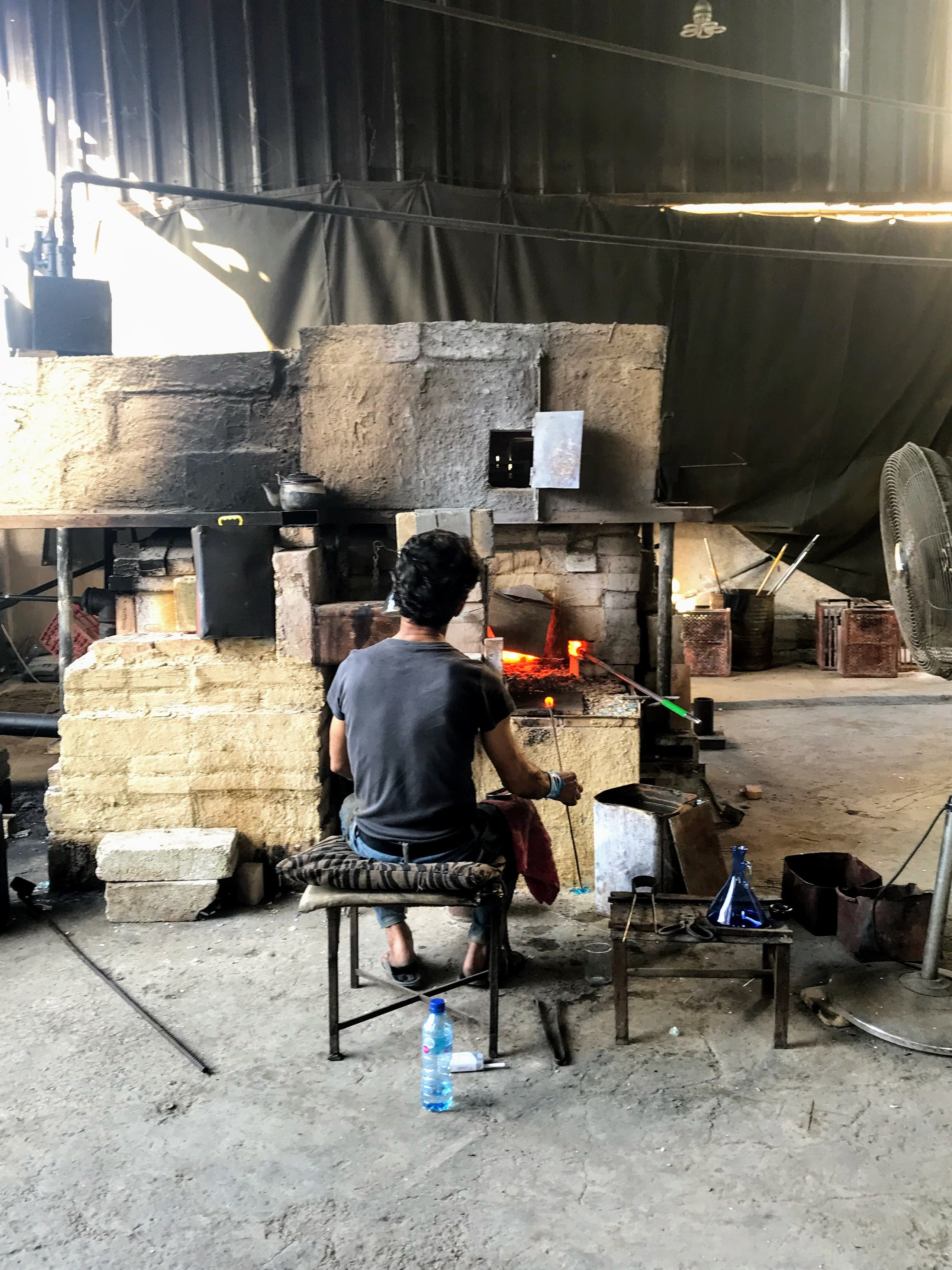 A member of the Khalifeh family in Sarafand, Lebanon works in the glass factory. (Supplied)