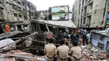 India building collapse toll climbs to 35, as rain hampers search and rescue efforts