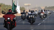 Bikers ride through Riyadh to celebrate Saudi Arabia's 90th National Day
