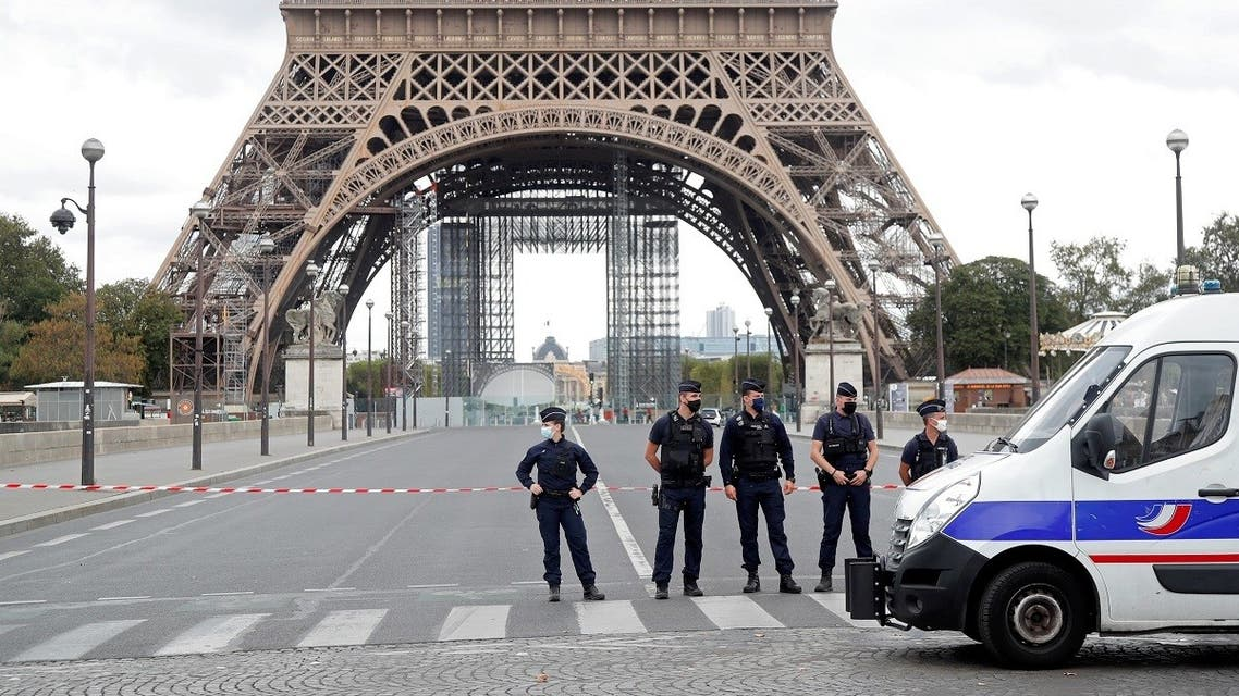 French police stand near the Eiffel Tower after the French tourism landmark was evacuated following a bomb alert in Paris, France, September 23, 2020. (Reuters)
