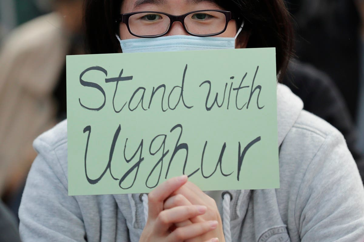 A man holds a sign during a rally to show support for Uighurs and their fight for human rights in Hong Kong. (File photo: AP)