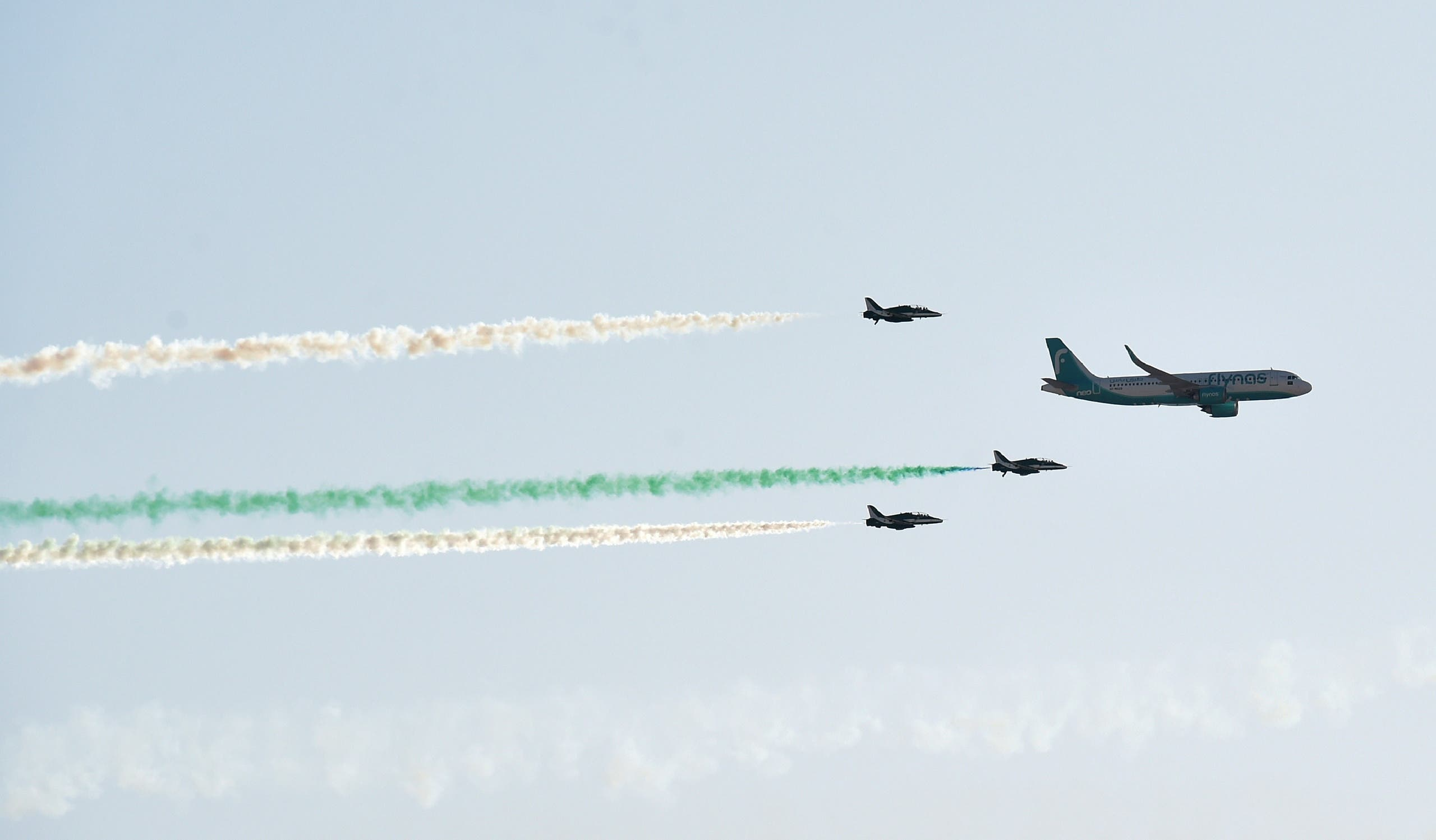 Civil and military aircrafts fly over Riyadh during celebrations marking Saudi Arabi's 90th National Day on September 23, 2020. (AFP)