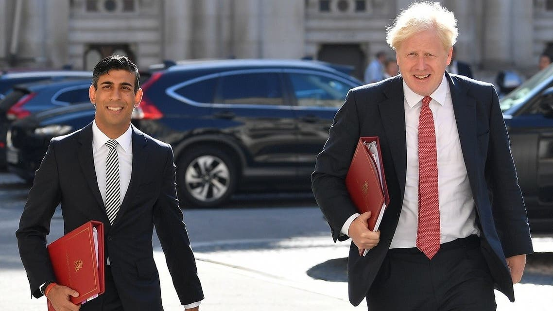 Britain's Chancellor of the Exchequer Rishi Sunak and Prime Minister Boris Johnson arrive to attend a Cabinet meeting at the Foreign and Commonwealth Office (FCO) in London, Britain. (Reuters)