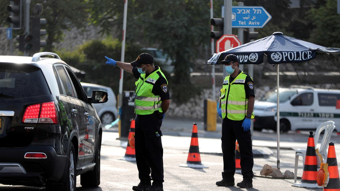 Israeli police check a car at a check point after Israel entered a second nationwide lockdown amid a resurgence in new coronavirus disease (COVID-19) cases, forcing residents to stay mostly at home during the Jewish high-holiday season, at the entrance to Jerusalem September 19, 2020. (Reuters)