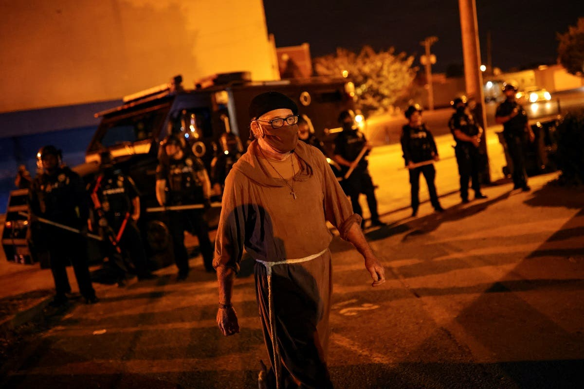 Protesters march a day after a grand jury considering the March killing of Breonna Taylor in Louisville. (Reuters)