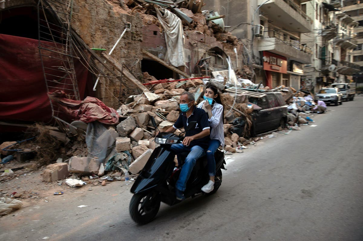 People on a scooter drive by damaged traditional Lebanese house in Beirut. (File photo: Reuters)