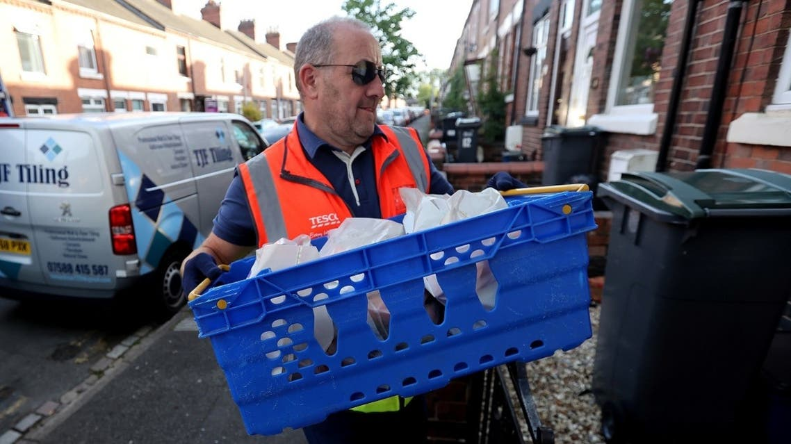 Tesco Delivery Driver Paul Bradbury delivers shopping to customers during his delivery round, following the outbreak of the coronavirus disease (COVID-19), Stoke-on-Trent, Britain. (Reuters)