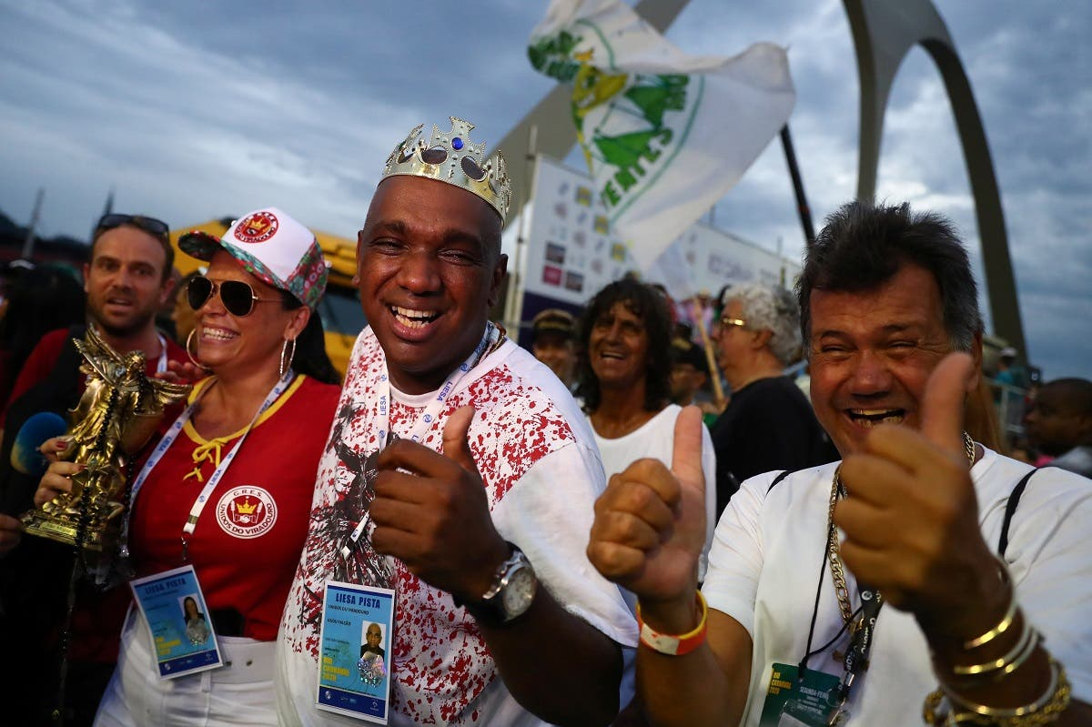 Members of Viradouro samba school react after winning the carnival's annual competition, at the Sambadrome in Rio de Janeiro, Brazil February 26, 2020. (Reuters)