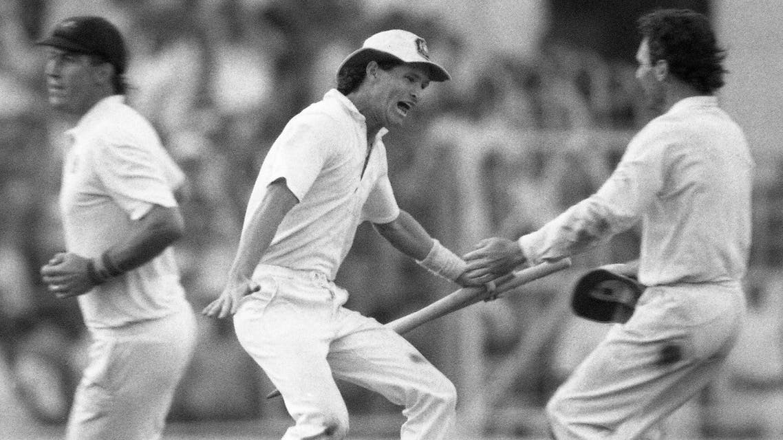 In this Nov. 8, 1987 file photo, Australian batsman Dean Jones holds the stumps as he races to embrace team captain Allan Border, right, in a moment of jubilation, in Calcutta, India. (AP)