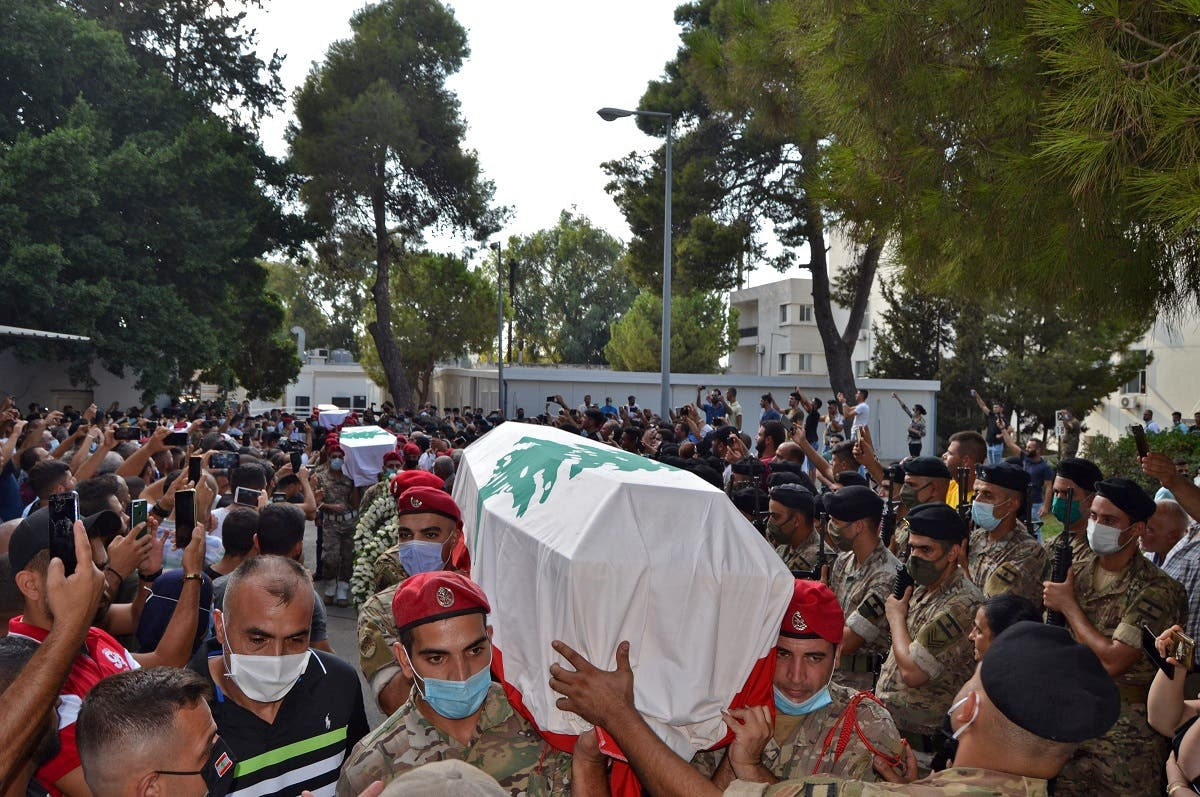 Lebanese soldiers carry the coffins of four comrades who were killed in the northern city of Tripoli, September 14, 2020. (AFP)