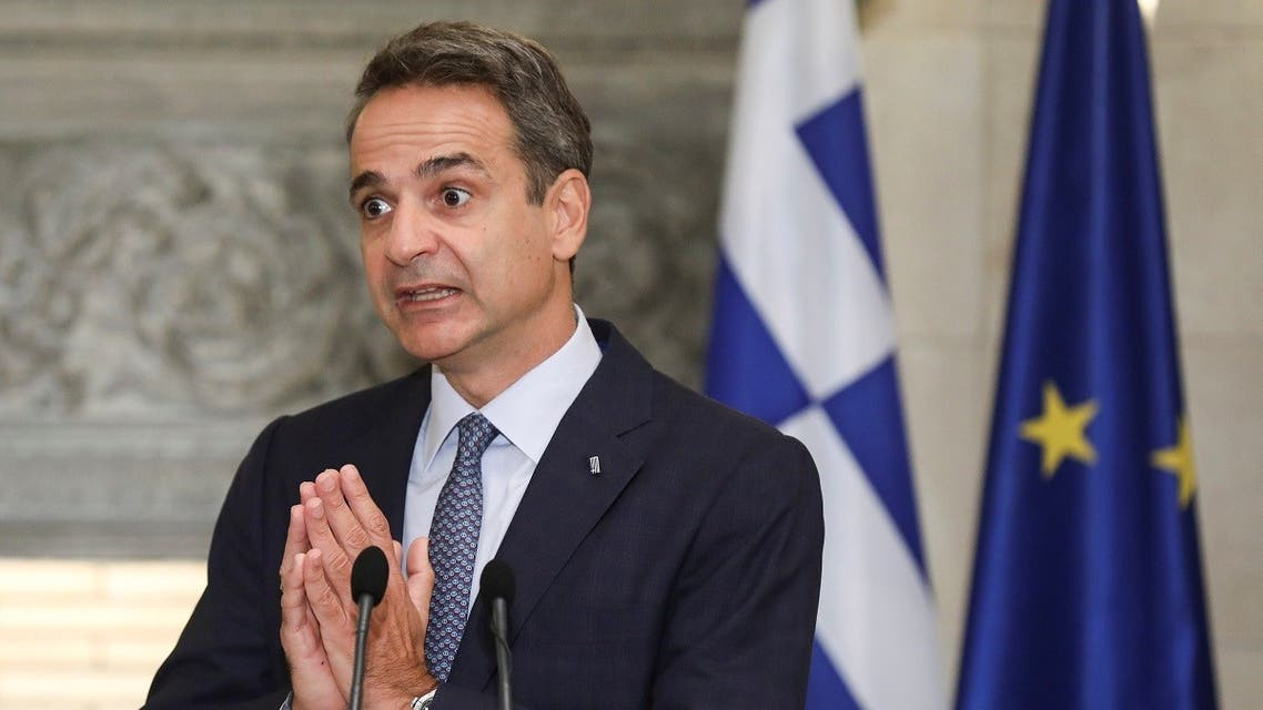 Greek Prime Minister Kyriakos Mitsotakis gestures during a news conference. (Reuters)