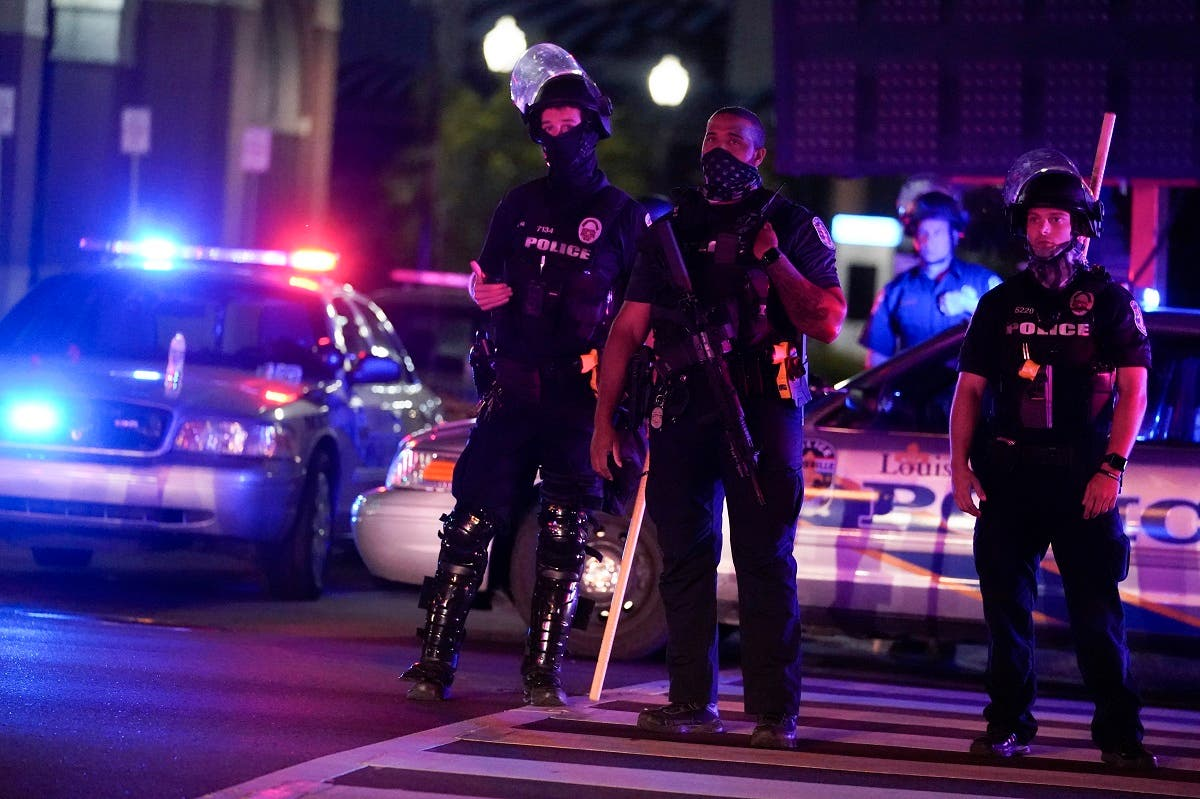 Police stand on the street moments before curfew, Thursday, Sept. 24, 2020, in Louisville, Ky. (AP)