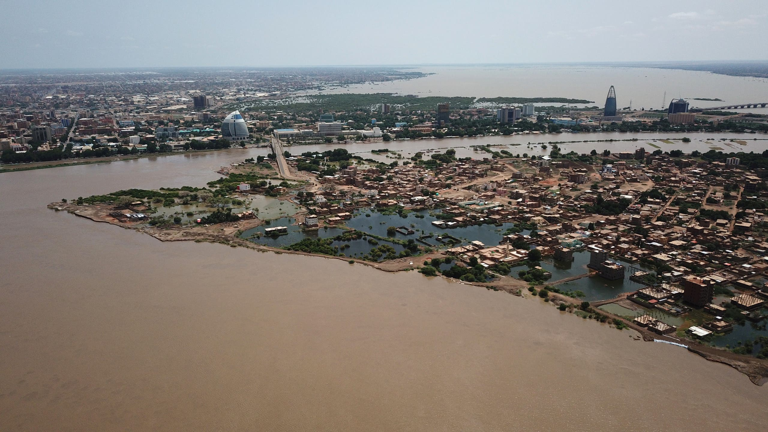 An aerial view shows buildings and roads submerged by floodwaters near the Nile River in South Khartoum. (Reuters)