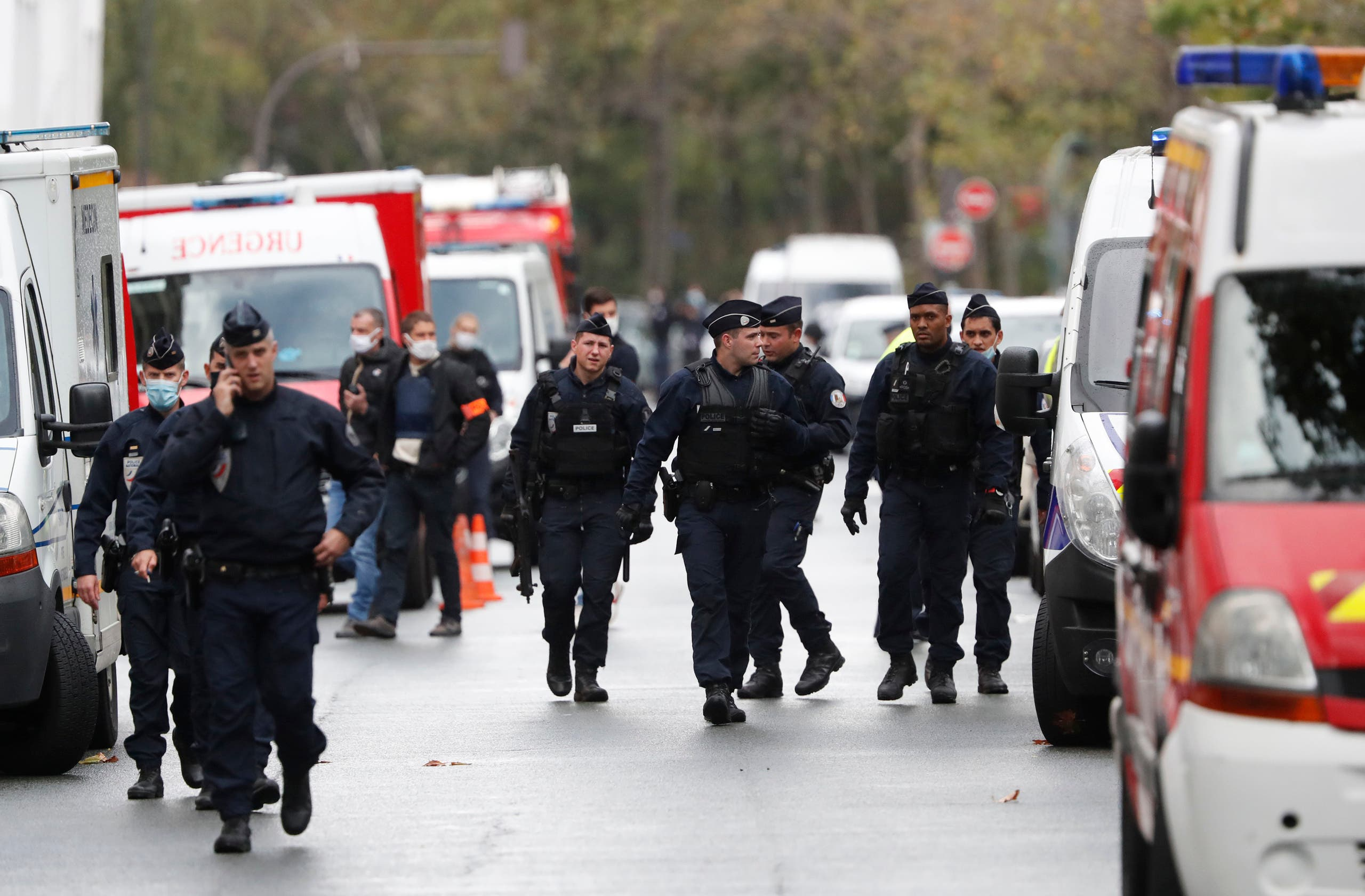 French police officers patrol after four people have been wounded in a knife attack near the former offices of satirical newspaper Charlie Hebdo. (AP)