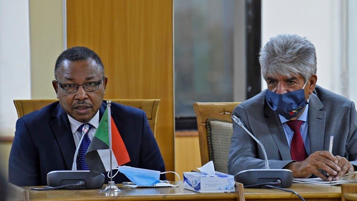 Sudan's Foreign Minister Omar Gamaledinne and the mask-clad Secretary General of Bahrain's Royal Charity Organisation (RCO) Mustafa al-Sayed meet in Khartoum, Sept. 14, 2020. (AFP)