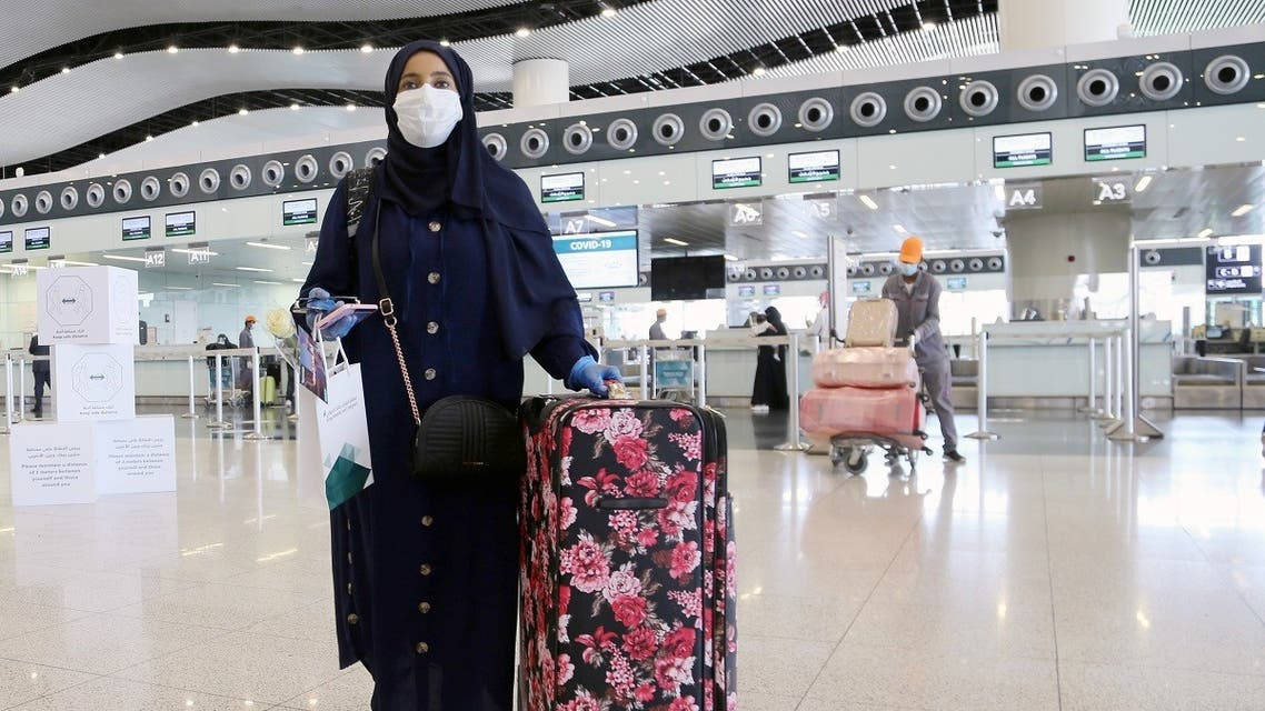 A passenger wearing a protective face mask walks at Riyadh International Airport. (File photo: Reuters)