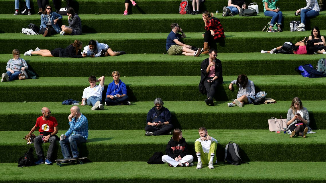People are seen relaxing in an outdoor seating area, whilst the reproduction R number of COVID-19 infections in the United Kingdom has risen and may be above 1, London, Britain. (Reuters)