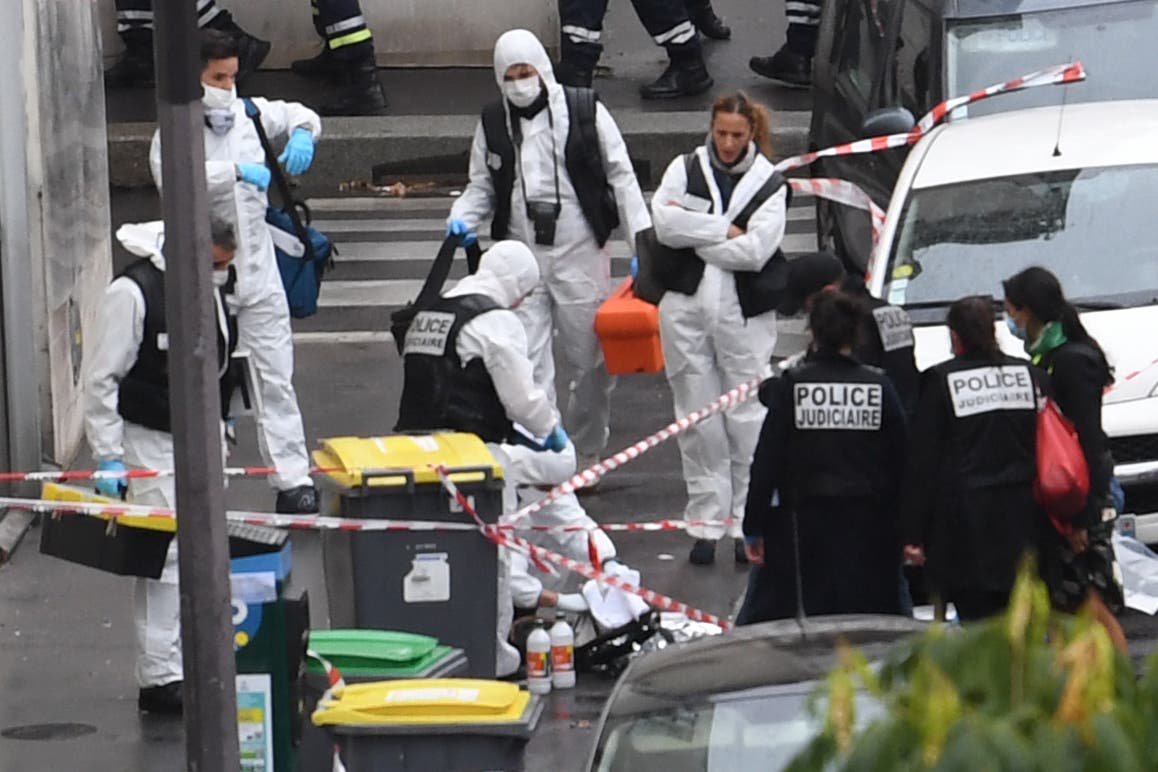 French police and forensic officers inspect the scene of an attack after several people were injured near the former offices of the French satirical magazine Charlie Hebdo. (AFP)