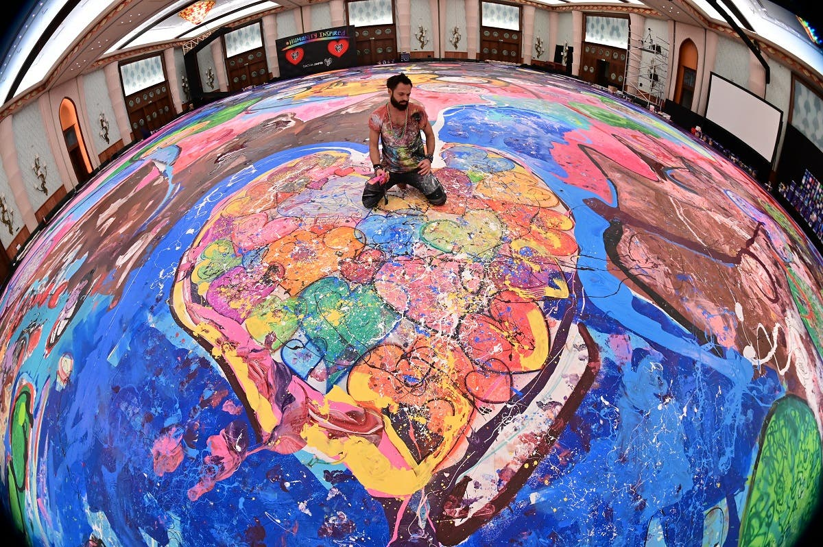 The painting, which measures the size of two football fields, can be seen at a hotel in Dubai, where Jafri spent months of lockdown due to the coronavirus pandemic. (AFP)