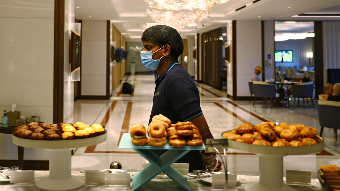 A waiter wearing a face mask walks past a buffet in the Atlantis The Palm hotel, as the Emirates reopens to tourism amid the coronavirus disease (COVID-19) outbreak, in Dubai , United Arab Emirates July 7, 2020. (Reuters)