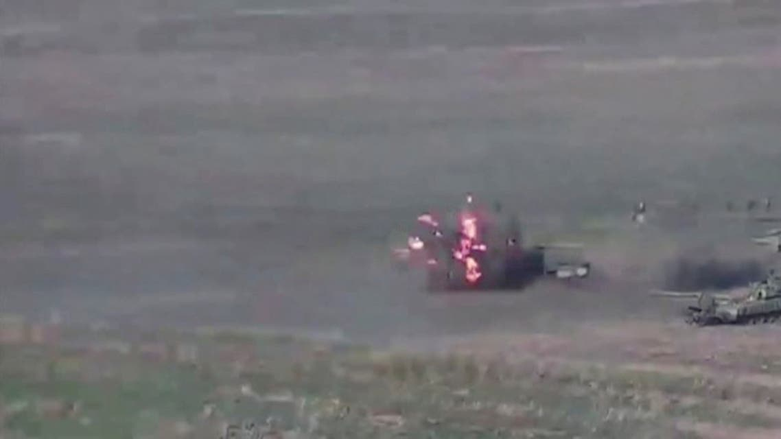 A still image from a video released by the Armenian Defence Ministry shows what is said to be Azerbaijani tanks, one of which is destroyed by Armenian armed forces in the breakaway region of Nagorno-Karabakh, in this still image from footage released September 27, 2020. (Reuters)