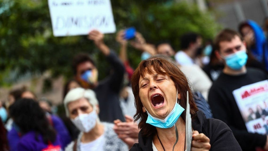 Demonstrators protest against the regional government's measures to control the spread of the coronavirus at Vallecas neighborhood, in Madrid, Spain, September 27, 2020. (Reuters)