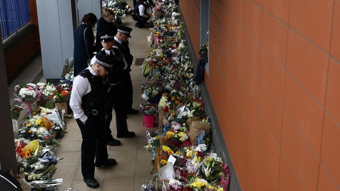 Police officers pay their respects at the custody centre where a British police officer has been shot dead in Croydon, south London, Britain, September 26, 2020. (Reuters)