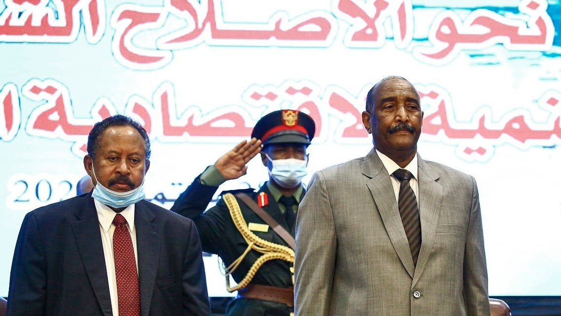 (L to R) Sudan's Prime Minister Abdalla Hamdok and Sovereign Council chief General Abdel Fattah al-Burhan attend the opening session of the First National Economic Conference in the capital Khartoum on September 26, 2020. (AFP)