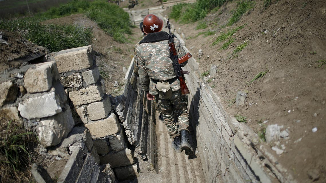 Ethnic Armenian soldiers walk in a trench at their position near Nagorno-Karabakh's boundary, April 8, 2016. (File photo: Reuters)