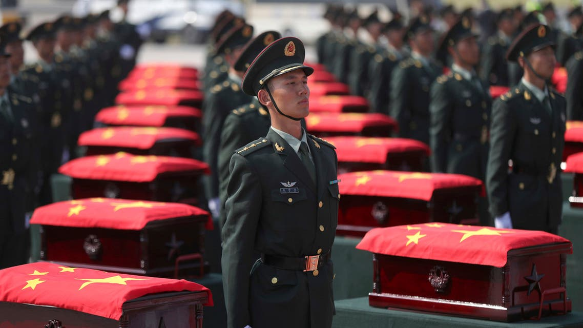 In this photo provided by China's Xinhua News Agency, caskets containing the remains of Chinese soldiers killed in the Korean War are escorted by honor guards at the Taoxian international airport in Shenyang, northeast China's Liaoning Province, Sunday, Sept. 27, 2020. (AP)