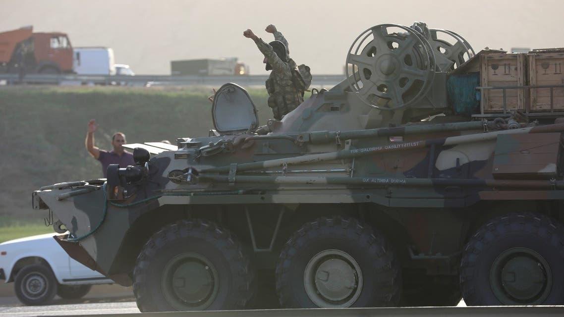 An Azerbaijani service member drives an armoured carrier in Baku. (Reuters)