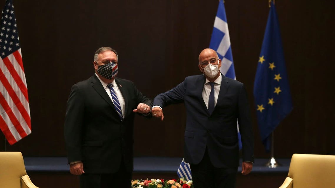 U.S. Secretary of State Mike Pompeo, left, and Greek Foreign Minister Nikos Dendias touch elbows during their meeting in the northern city of Thessaloniki, Greece, Monday, Sept. 28, 2020. (AP)