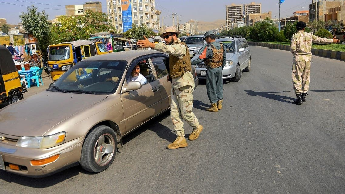 Afghan National Police personnel stop cars at a check point in Herat on September 27, 2019. (AFP)