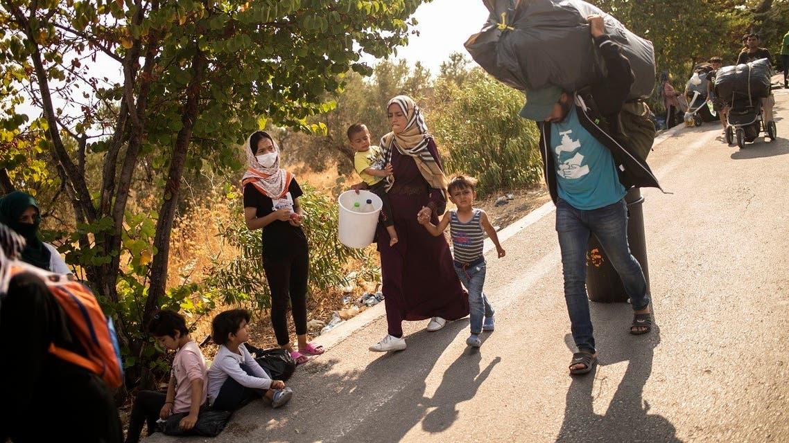 Migrants walk on the road near the Kara Tepe camp on the island of Lesbos on September 15, 2020. (AFP)