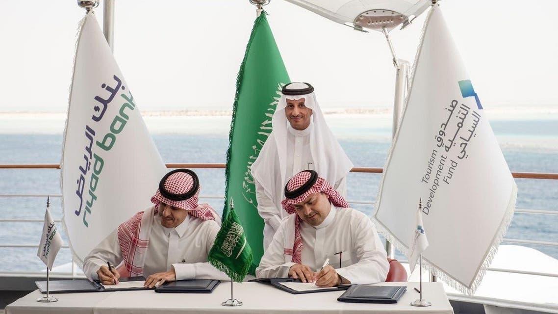 Representatives from Saudi Tourism Development Fund and Riyadh Bank sign a deal in the presence of Saudi Arabia's Tourism minister Ahmed al Khateeb. (Twitter/@RiyadBank)