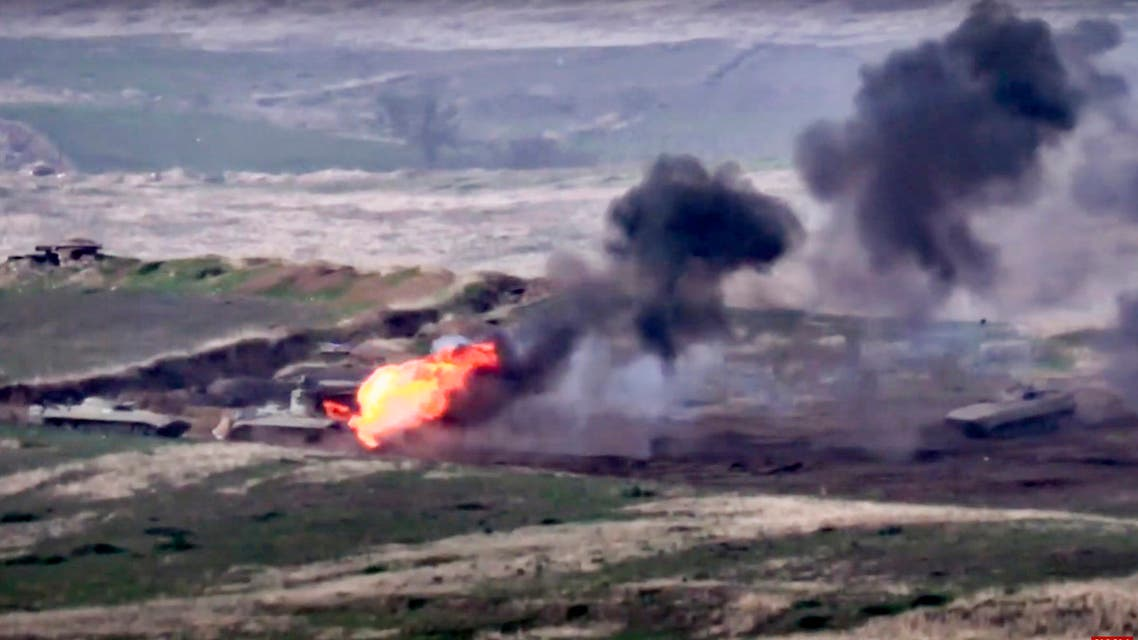 In this image taken from a footage released by Armenian Defense Ministry on Sunday, Sept. 27, 2020, Armenian forces destroy Azerbaijani military vehicle at the contact line of the self-proclaimed Republic of Nagorno-Karabakh, Azerbaijan. (AP)