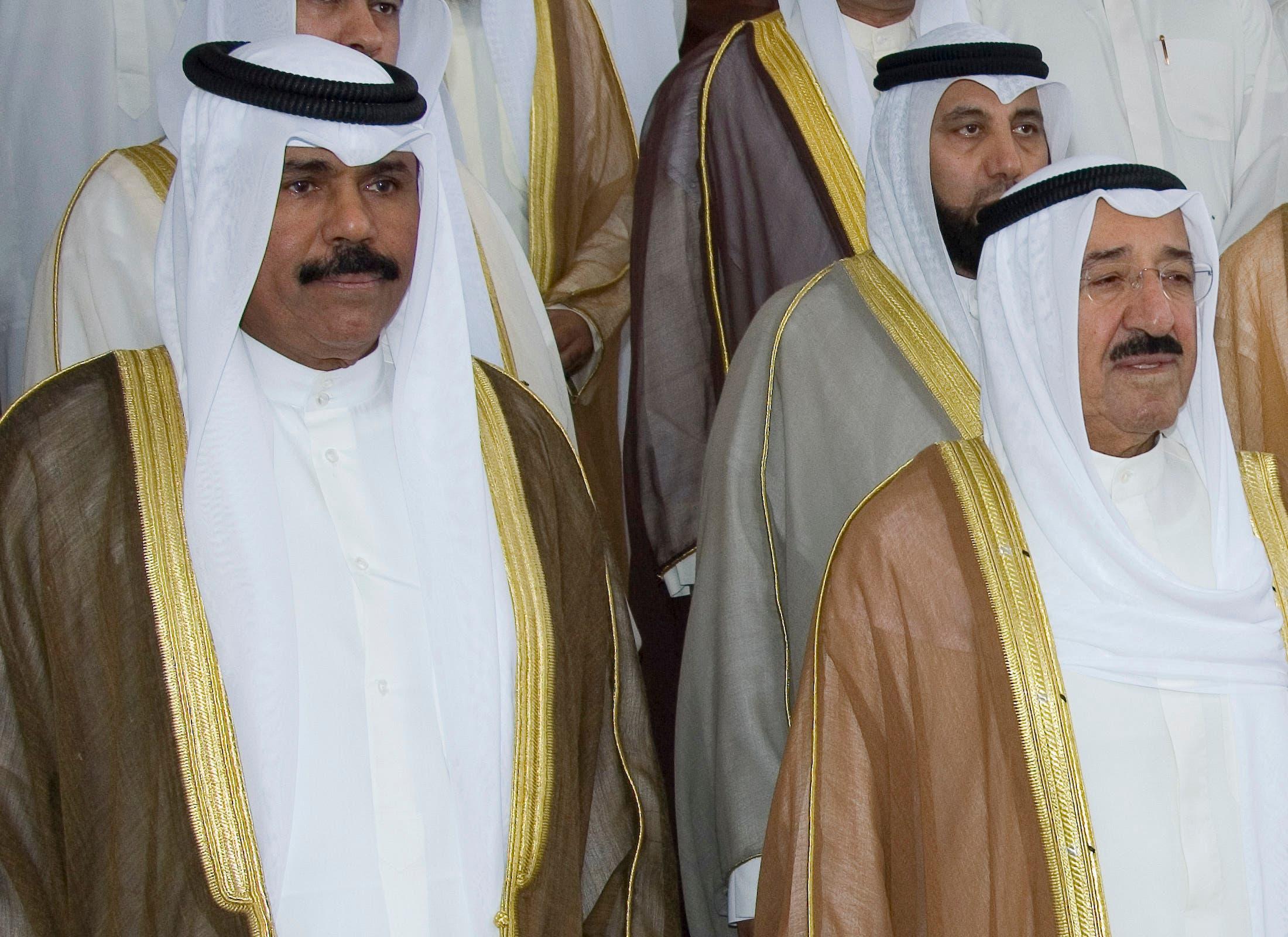 Kuwait's Emir Sheikh Sabah al-Ahmad Al-Sabah (R), Crown Prince Sheikh Nawaf al-Ahmad Al-Sabah (L) stand on the steps of the Parliament building October 30, 2006. (Reuters)
