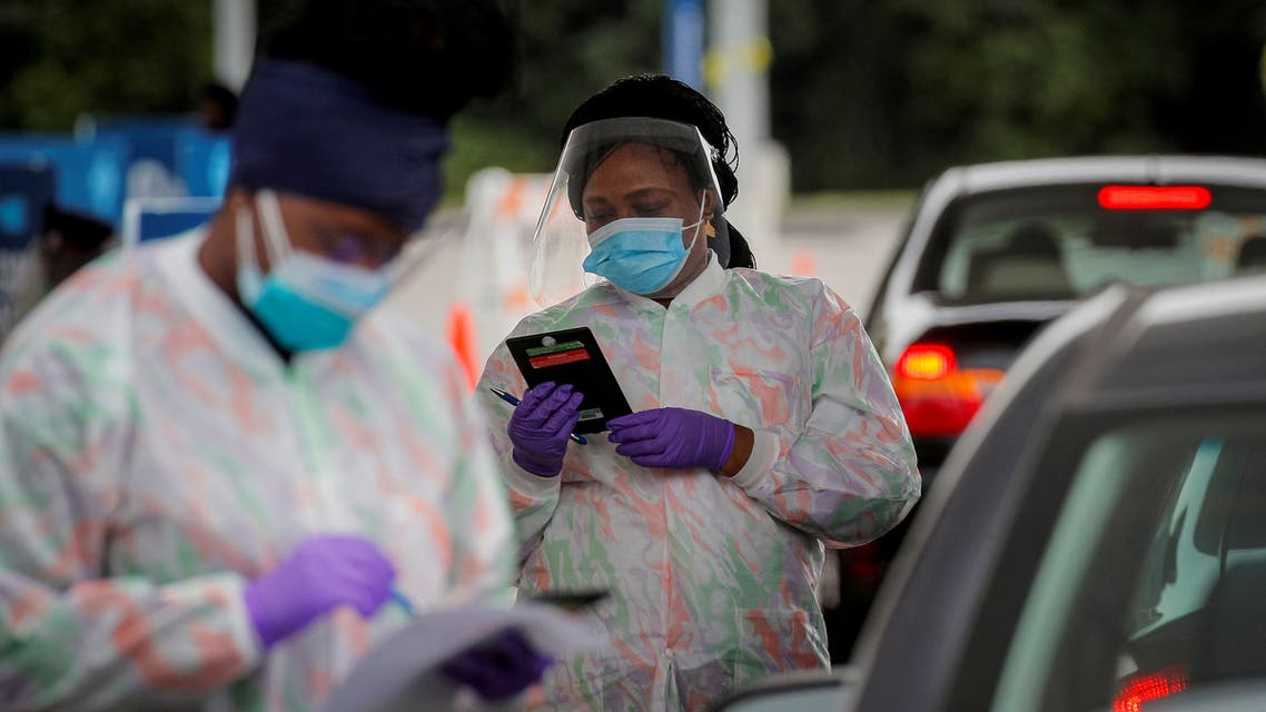 Medical technicians work at a drive-through coronavirus testing facility in New York, US September 17, 2020. (Reuters)