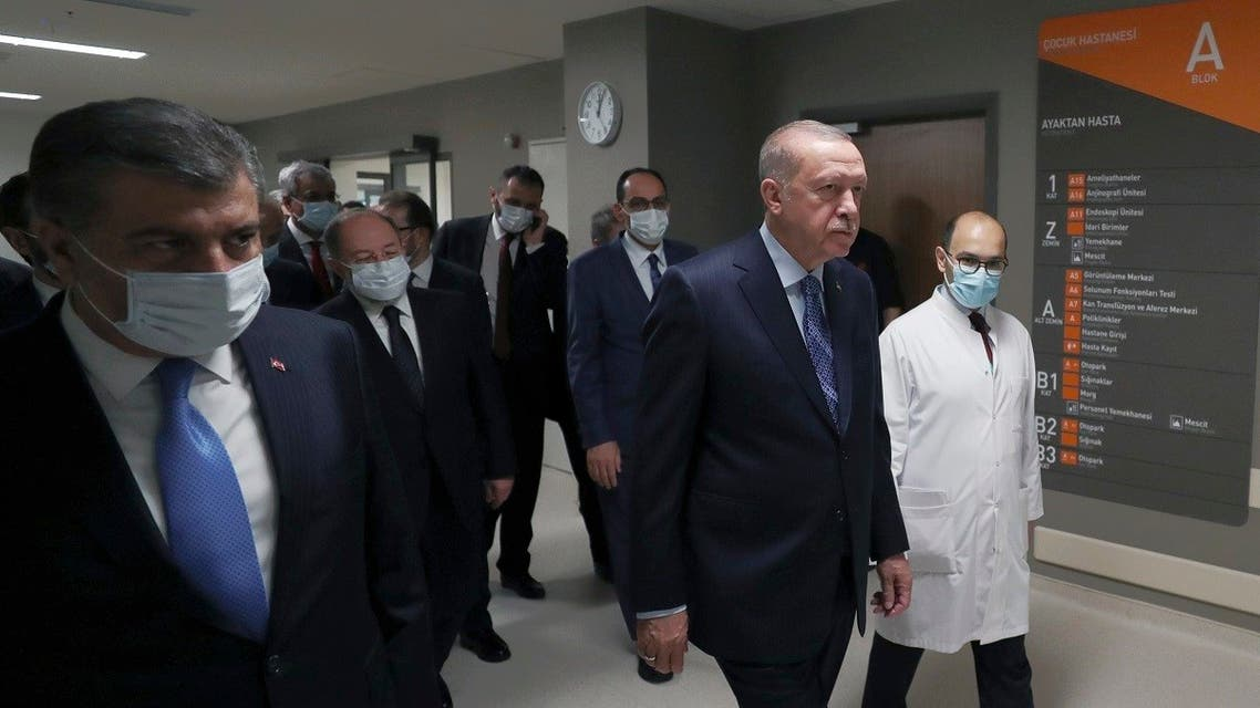 Turkey's President Recep Tayyip Erdogan, front center, arrives to attend the inauguration ceremony for Basaksehir Pine and Sakura City Hospital, in Istanbul, Thursday, May 21, 2020. (Turkish Presidency via AP)