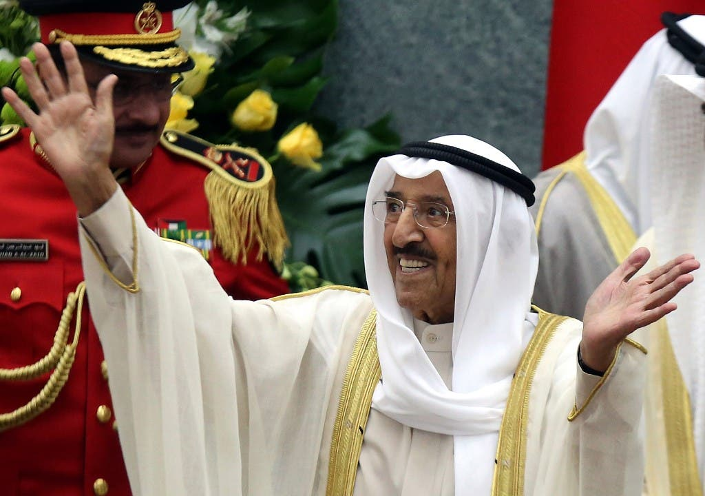 Kuwait's Emir Sheikh Sabah al-Ahmad Al-Sabah waves upon his arrival to open the parliament's new term at the Gulf emirate's National Assembly in Kuwait City in 2019. (AFP)